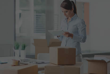 Business woman packing her office. Commercial movers. Professional affordable movers near me.